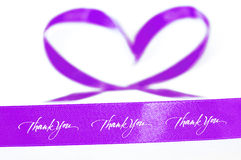 Pink ribbon of gratitude and love. Gratitude and love expression pink ribbon concept on white background Stock Photo