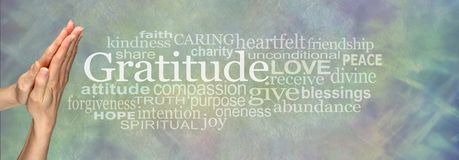 Gratitude Prayer Word Tag Cloud. Female hands in prayer position beside the word GRATITUDE and a relevant word cloud on a pale blue green stone effect background royalty free stock photography