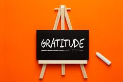 Gratitude Word On Blackboard. Gratitude written on blackboard on tripod with chalk. Gratitude Practice royalty free stock image