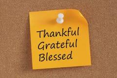 Grato, grato e Blessed escritos na nota fotos de stock