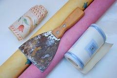 Grattoir de papier peint. images libres de droits