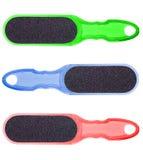 Grattugia di plastica per i vostri piedi, strumento per il manicure e pedicure, su un fondo bianco. Immagini Stock Libere da Diritti