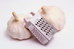 Grattugia e garlics Immagini Stock Libere da Diritti