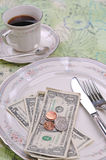 Gratuity. Conceptual image of the dollar and coins on the dinner plate Stock Images