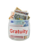 Gratuity. Conceptual photo of a gratuity. Euro and dollar banknotes in a glass jar isolated over white Royalty Free Stock Photos
