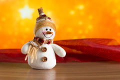 Gratulerar den felika snögubben för jul Arkivbild
