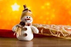 Gratulerar den felika snögubben för jul Fotografering för Bildbyråer
