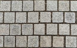 Grau cobbles strukturierten Hintergrund Stockfotos