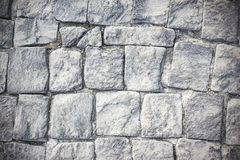 Grau entsteint Pflasterziegelhintergrund Stockbilder