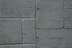 Grau gemalter Ziegelstein- und Blockhintergrund Stockfotos