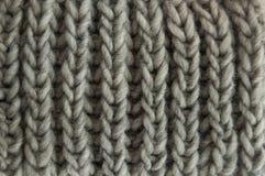 Grau gestrickte Wolle Stockbild