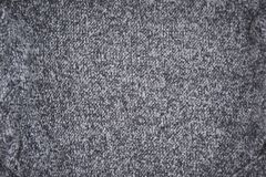 Grau gestrickter Beschaffenheitsmusterhintergrund lizenzfreie stockbilder