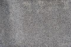 Grau konkret mit Kieswandhintergrund lizenzfreies stockbild