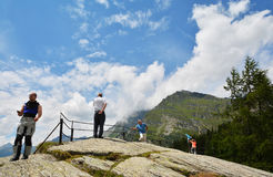 People looking the view from Maloja - Kulm Hotel on Maloja Pass road Stock Image