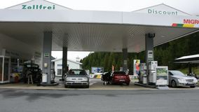 Swiss and traveler people fill oil to tank of car in petrol station at Villages. Graubunden, Switzerland - September 2 : Swiss and traveler people fill oil to stock video footage