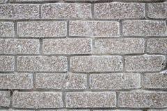 Graue Backsteinmauer für Hintergrund und Beschaffenheit Stockfoto