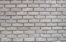 Graue Backsteinmauer für Hintergrund und Beschaffenheit Lizenzfreie Stockfotografie