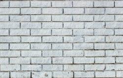 Graue Backsteinmauer für Hintergrund und Beschaffenheit Stockbild