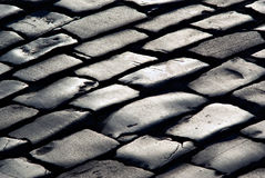Graue Beschaffenheit von den Zeilen des Steinpflastersteins Lizenzfreie Stockbilder