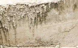 Graue Betonmauerbeschaffenheit Stockfoto