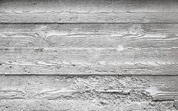 Graue Betonmauerbeschaffenheit mit hölzernem Muster Stockbilder