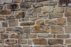 Graue Farbe des Musters der dekorativen ungleichen gebrochenen wirklichen Steinwandoberfläche des modernen Artdesigns mit Zement Stockfotos