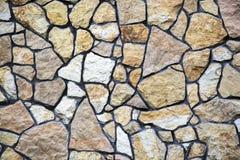 Graue Farbe des Musters der dekorativen ungleichen gebrochenen wirklichen Steinwandoberfläche des modernen Artdesigns mit Zement Lizenzfreies Stockfoto