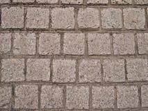 Graue farbige quadratische geformte Steinziegelsteine Stockfotografie