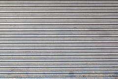 Graue Farbmetallrollenfensterladentürbeschaffenheit und -hintergrund lizenzfreies stockfoto