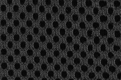 Graue Faser mit den schwarzen Löchern oben gesehen vom Abschluss Stockbilder