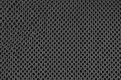 Graue Faser mit schwarzen Löchern Stockbilder