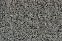 Graue Fußmatte Stockfoto