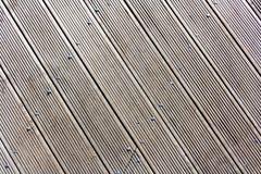 Graue hölzerne Beschaffenheit der Wand mit diagonalen Linien lizenzfreies stockfoto