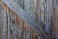 Graue hölzerne Beschaffenheit einer alten Tür Stockfotos