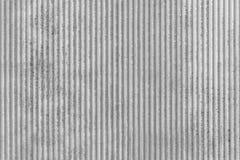 Graue Hintergrundbeschaffenheit mit Nuten lizenzfreie stockfotos
