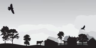 Graue Landschaft mit Bäumen und Dorf Stockfotografie