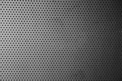 Graue Metallplatte mit Punkten und Schrauben Stockfotografie