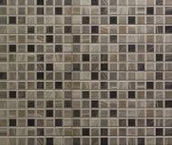 Graue Mosaikfliesen Stockbild