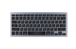 Graue Plastiktastatur mit den schwarzen Knöpfen lokalisiert auf weißem Hintergrund Lizenzfreies Stockfoto