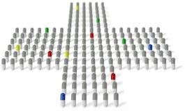 Graue und farbige Medikamentkapseln vereinbarten in Kreuz Lizenzfreie Stockfotografie