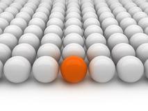Graue und orange Kugeln der Individualität - Lizenzfreie Stockfotografie