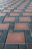 Graue und rote Steinziegelsteinbodenbeschaffenheit und -hintergrund Lizenzfreies Stockbild