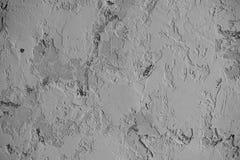 Graue Wand mit Klecksen des Kitts oder der Farbe Beschaffenheit oder Hintergrund Stockbild