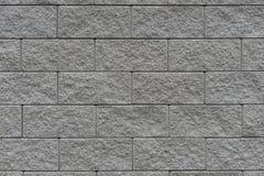 Graue Wand mit Klinkerziegelsteinen Lizenzfreie Stockfotografie