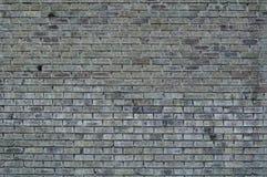 Graue Wand von den Ziegelsteinen Stockbild
