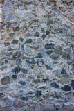 Grauer alter Steinwandhintergrund stockbilder