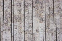 Grauer alter Steinwandhintergrund lizenzfreie stockfotografie
