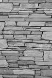 Grauer Backsteinmauerhintergrund Lizenzfreies Stockbild