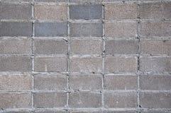 Grauer Blockwandhintergrund Lizenzfreie Stockbilder