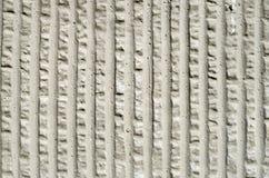 Grauer dekorativer Entlastungsgips auf Wand Lizenzfreie Stockfotografie